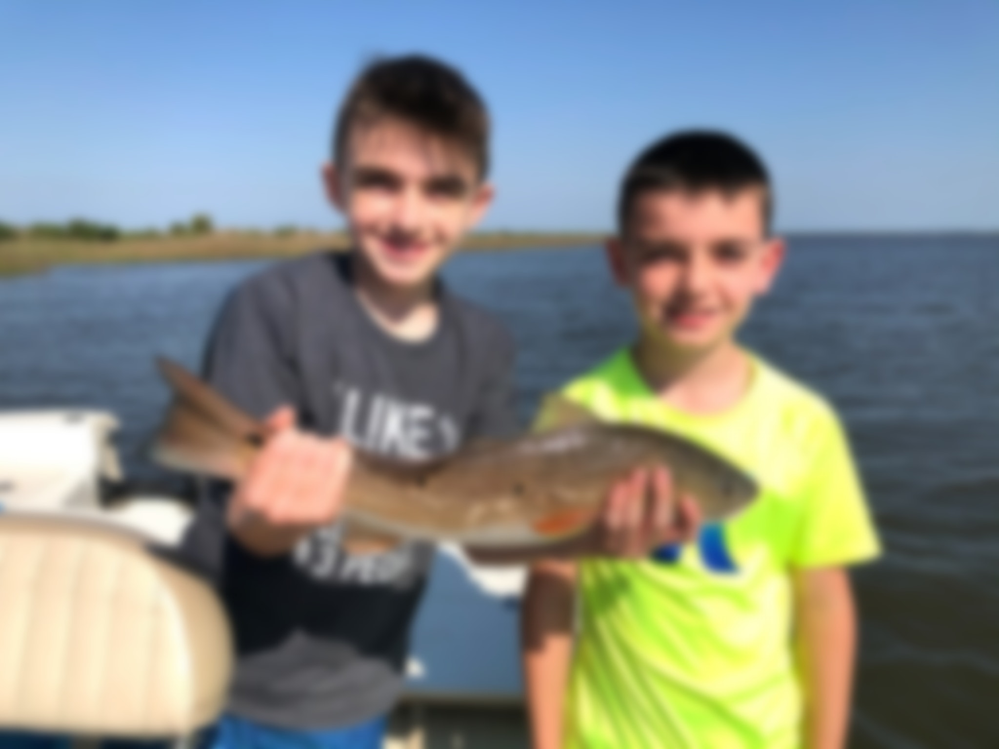 Two Boys With Speckled Trout
